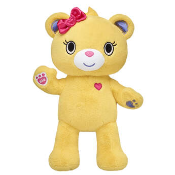 Meet Bearnice! Known for her funny and friendly personality, this little golden kawaii bear has blue paw pads and a pink heart on her fur. Add fun Kabu outfits and accessories to your Bearnice kawaii bear and explore your new world together! Shop online or in store at Build-A-Bear Workshop!