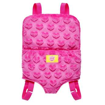 You can easily tote around your favorite furry friend in this adorable pink bear carrier! This backpack carrier has a pink heart pattern and is the perfect size for fitting a furry friend inside. It makes it super easy to bring your furry friend on any adventure! at Build-A-Bear®
