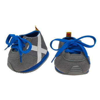 Teddy bear size gray athletic shoes have white stripes and blue laces.