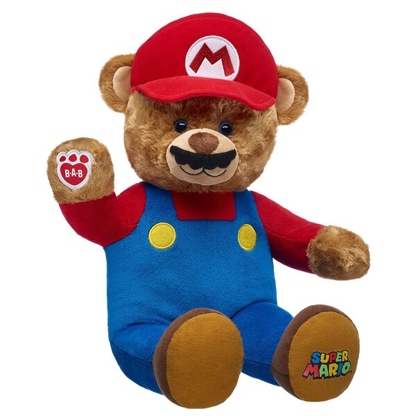 WOOHOO! Everyone's favourite mustached-hero is joining the Make-Your-Own fun! With his built-in suit, iconic mustache and Super Mario logo on his paw pad, Mario Bear is ready to jump to the rescue! Make a beloved global icon in furry friend form and add Mario Bear to your all-star team! ™ & © 2017 Nintendo.