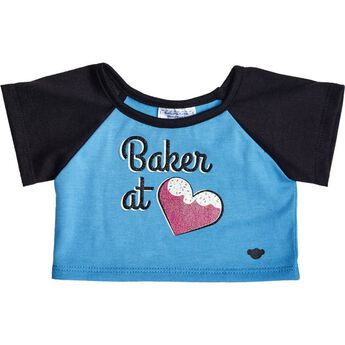 How sweet! Dress your furry friend in a Baker at Heart T-shirt. This turquoise tee has black sleeves and a Baker at Heart graphic on the front. This pink heart is topped with icing and sprinkles. Mmm!