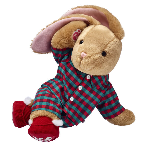 Everyone's favourite floppy-eared bunny is here to stuff the Christmas season with fun! Pawlette is super cute and cosy in these adorable plaid pyjamas and red and white slippers.  This gift set makes a cuddly companion that's perfect for Christmas morning and winter adventures.  Make it a season to remember with this adorable plush bunny gift set. Sweet dreams!
