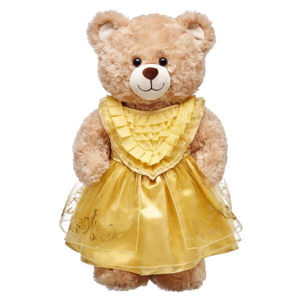 "In Disney's live-action movie ""Beauty and the Beast,"" Belle's ball gown sparkles in the candlelight of the castle ballroom, and now your furry friend can partake in the same splendor with this dress fit for a night of enchantment! Belle's dress is a beautiful gold color with silver sparkles on the ruffles at the top. The bottom of the dress is also adorned with a silver trim designed for an added shine. The perfect look for your Belle Inspired Bear, this dress is sure to delight.©Disney"