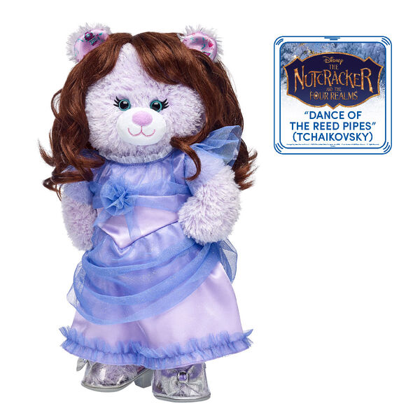 "Experience the magic when you enter the fantasy world of the Four Realms with Disney Nutcracker Bear! This deluxe teddy bear gift set features Disney Nutcracker Bear with brown hair and a purple dress that looks just like Clara's in Disney's ""The Nutcracker and the Four Realms."" This enchanting stuffed animal gift set is sure to dazzle!"