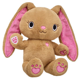 Meet Pawlette! This sweet kawaii bunny has soft brown fur, pink paw pads and super floppy ears. Creative and artistic, Pawlette can also be a little shy at times. She's a very encouraging friend and has been known to help settle a group conflict or two. Dress your Pawlette kawaii bunny plush toy in PAWsome Kabu outfits and accessories! Shop online or in store at Build-A-Bear Workshop!