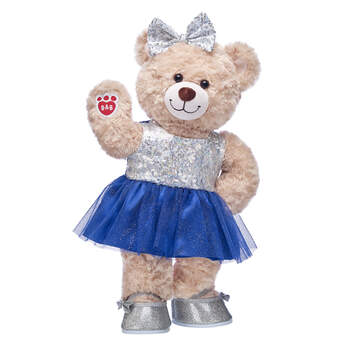 Add some sparkle and shine to your gift-giving this year! This Happy Hugs Teddy stuffed animal gift set will brighten anyone's day with its sequins and sparkly tulle dress! Plus, this lovable teddy bear comes with a matching hair bow and pair of flats.