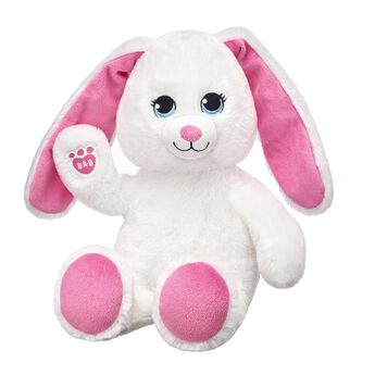 Online exclusive! Put a little spring in your step with Soft Spring Bunny! This cheerful stuffed rabbit has soft white fur with floppy pink ears and paw pads.  Make your own Easter fun at Build-A-Bear Workshop! Customize your furry friend with unique clothing & accessories to make the perfect gift.