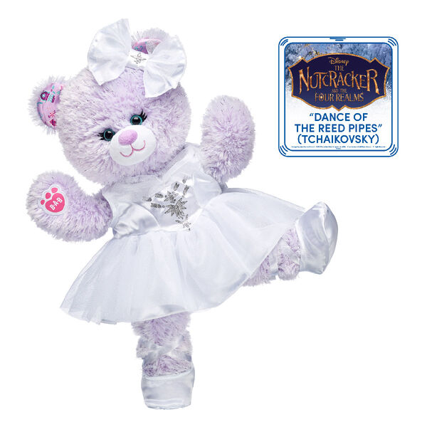 "Disney Nutcracker Bear can dance and twirl in this cute ballerina gift set! Inspired by Disney's ""The Nutcracker and the Four Realms,"" this teddy bear gift set includes the enchanting Disney Nutcracker Bear dressed in a sparkly white dress, a hair bow and a pair of ballet flats."