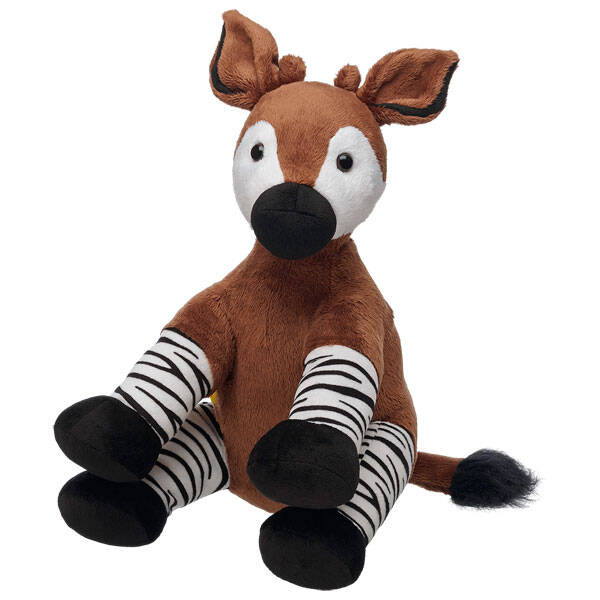 """The """"forest giraffe"""" has a velvety coat with a brown body and black and white striped legs. Personalize it with clothing and accessories to make the perfect unique gift."""