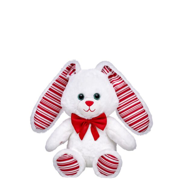 Pass the peppermint and snuggle up with this 8-inch Build-A-Bear Buddies™ Sweet Candy Bunny. The soft white plush bunny has peppermint striped ears and paw pads, as well as a red bow tie. NOTE: This item cannot be purchased unstuffed, nor can stuffing adjustments be made. A sound or scent cannot be placed inside this pre-stuffed item. Build-A-Bear Buddies only fit in Build-A-Bear Buddies clothing.