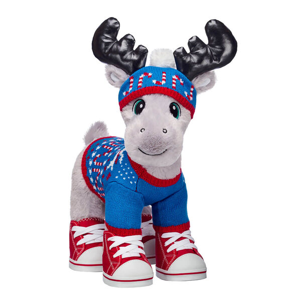 Grey Gust Moose has journeyed all the way from the North Pole to make the perfect Christmas gift! This smiley moose stuffed animal has soft grey fur and big black antlers. Plus, it's festive sweater outfit will keep him warm all winter long. This stuffed animal gift set is sure to create a lot of warm smiles this Christmas!