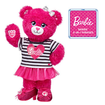 """Give Barbie™ Bear a twirl with this pink-tastic stuffed animal gift set!  Barbie™ Bear is cute as can be in her tutu outfit and sparkly fuchsia heels. <p>Price includes:</p>  <ul>    <li>Barbie™ Bear</li>    <li>Barbie™ Tutu Outfit 2 pc. </li>    <li>Barbie™ Fuchsia Sparkle Heels</li>    <li>Multicolor Sparkle Bow Set 4 pc.</li> </ul>  ©2018 Mattel. All Rights Reserved."""