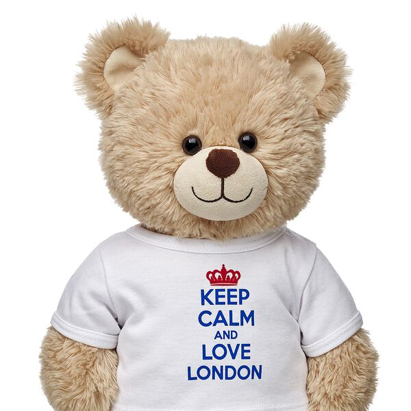 "Keep calm and dress your furry friend in this tee. This white tee features the phrase ""Keep Calm and Love London."" It makes the perfect souvenir for a visit to London."