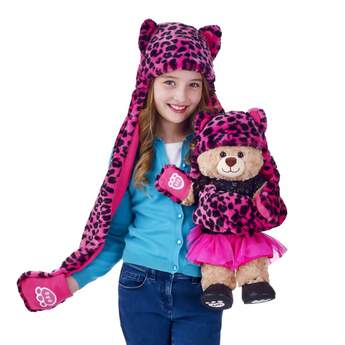 Keep warm and stylish this winter with the combination hat, scarf and mitten set. The all-in-one fuchsia with black leopard print winter accessory fits a child and matches the set made to fit a furry friend, sold separately. One of the paw-like mittens displays the B-A-B paw logo.