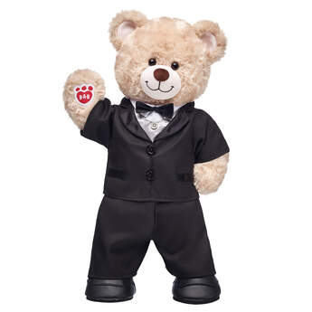 This teddy bear groom is all dressed and ready for the big day! Happy Hugs looks BEARY handsome in its black tuxedo and dress shoes. <p>Price includes:</p>  <ul>    <li>Happy Hugs Teddy</li>     <li>Black Tuxedo 2 pc.</li>    <li>Black Dress Shoes</li> </ul>