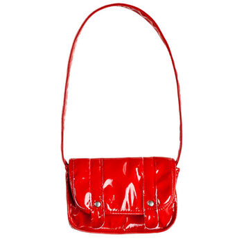 Complete your furry friend's look with a stylish Red Satchel. This bag has a shiny, patent leather look.