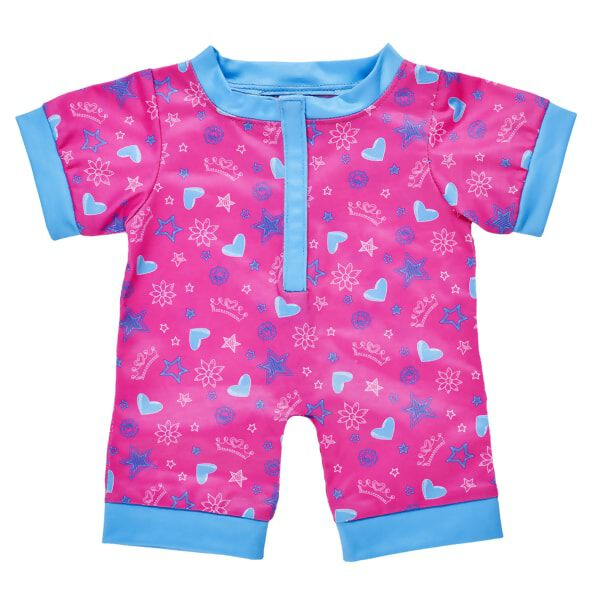 This blue and pink sleeper is an adorable bedtime look for any furry friend! This one piece pink sleeper has light blue trim around the neck, sleeves and ankles. An all-over pattern of stars, hearts and flower doodles gives it a playful look that's perfect for a slumber party!