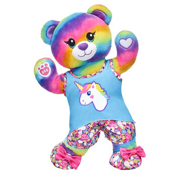 """Let their imagination run wild with this rainbow-inspired stuffed animal gift set! Rainbow Friends Bear is a vibrant teddy bear who looks cute as can be in its unicorn pyjama set. This teddy bear also has special paw pads that can attach to the paws of other Rainbow Friends animals so they can hug and hold hands! They'll drift off to a fantasy dreamland with this awesome gift set! <p>Price includes:</p>  <ul>    <li>Rainbow Friends Bear</li>    <li>Rainbow Unicorn Pyjamas </li>    <li>Rainbow Unicorn Slippers</li> </ul>"""