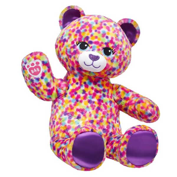 Pounce into a whirlwind of multicoloured fun with Rainbow Confetti Leopard! This wild cat has purple ears and paw pads and a super soft coat of spotted rainbow colours. Leap into fun by personalising  Rainbow Confetti Leopard with your favourite outfits and accessories!