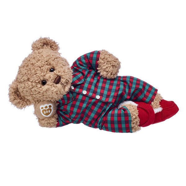 Cosy up with Timeless Teddy this Christmas! This classic teddy bear gift set makes a cuddly companion for winter adventures. This adorable teddy bear gift set features this fuzzy brown bear wearing bear-sized plaid pyjamas! Sweet dreams!