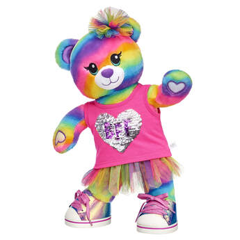 """Give them a gift that will colour their world with fun! This rainbow-iffic stuffed animal gift set features Rainbow Friends Bear in a bright BFF outfit. This teddy bear also has special paw pads that can attach to the paws of other Rainbow Friends animals so they can hug and hold hands! It's the PAWfect gift for your bestie! <p>Price includes:</p>  <ul>    <li>Rainbow Friends Bear</li>    <li>BFF Sequin Heart Tank Top </li>    <li>Rainbow Sparkle Tutu </li>    <li>Rainbow Tulle Headband </li>    <li>Metallic Low Top Shoes</li> </ul>"""