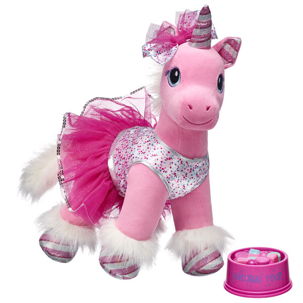 Swirl Unicorn is a magical stuffed plush unicorn who has journeyed all the way from the North Pole to Build-A-Bear Workshop! A shy but enchanting northern unicorn with a glittery candy cane horn, this pristine Build-A-Bear unicorn stuffed animal also has a pink coat with white fur and a bushy tail. This unicorn stuffed animal gift set even includes a glittery unicorn food toy for endless fun this Christmas season!