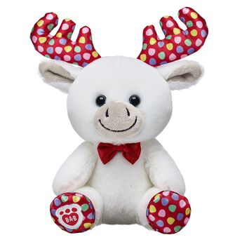 Satisfy your sweet tooth this winter with the adorable Build-A-Bear Buddies Gumdrop Moose! With a red bow tie and festive paw pads, this happy lil' plush moose is all set to celebrate the holidays. NOTE: Build-A-Bear Buddies only fit in Build-A-Bear Buddies clothing. This item cannot be purchased unstuffed, nor can stuffing adjustments be made. A sound or scent cannot be placed inside this pre-stuffed item.