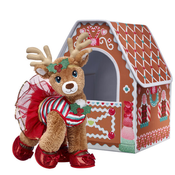 Vixen will look sweet as can be in her own Gingerbread House! This swift and sporty reindeer stuffed animal looks holly jolly in her adorable outfit, and she perfectly matches the candy-coated house where she can play! Give this cuddly reindeer stuffed animal gift set to make Christmas wishes come true!