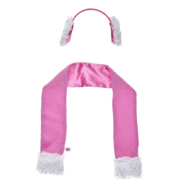 Keep your furry friend warm this winter with this stylish two-piece set! This look includes a pink scarf and a matching pair of fuzzy earmuffs.