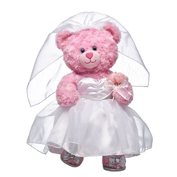 Pink Cuddles makes a beautiful teddy bride! This sweet gift set is the perfect choice for any happy couple. <p>Price includes:</p>  <ul>    <li>Pink Cuddles Teddy</li>     <li>Wedding Dress Set 3 pc.</li>    <li>Silver Sparkle Heels</li> </ul>