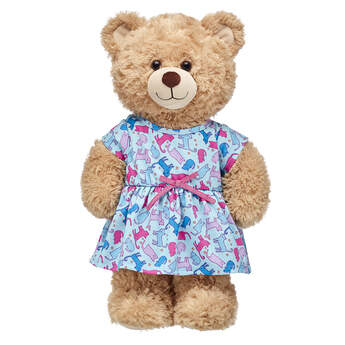 This fashionable dress is the cat's meow! This light blue knit dress for stuffed animals features an adorable all-over pattern of feline friends.