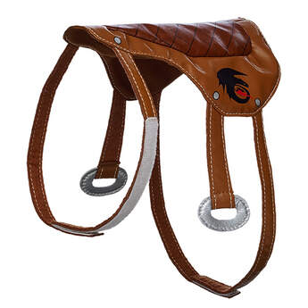 Dragon trainers can ride their dragons with this DreamWorks Dragons Saddle. This brown saddle has the Dragons logo on it. DREAMWORKS DRAGONS © 2016.