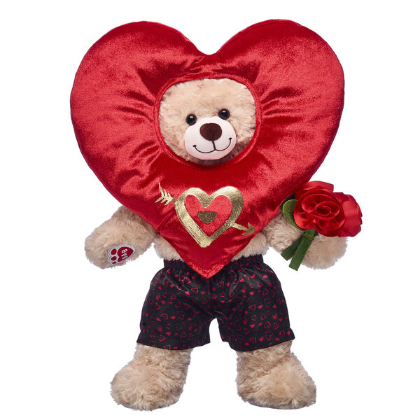 teddy bear with oversized heart costume and bouquet