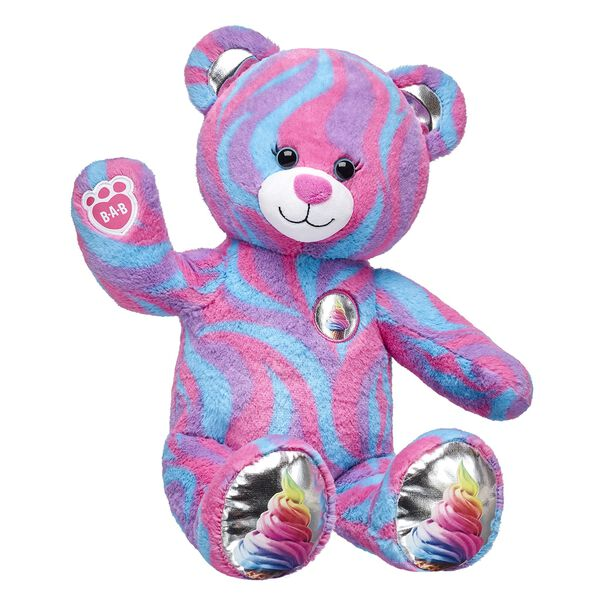 Get ready for an extra spoonful of frosty fun with this sweet bear! Sweet Swirls Ice Cream Bear has a swirly pattern on its fur that looks like colorful ice cream. The metallic paw pads sprinkle on a little extra fun, too. Adding a sweet scent or fun outfit to this colorful teddy bear makes for the perfect topping!