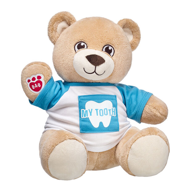 Losing a tooth is BEARY exciting, so make sure the tooth fairy pays a visit with this cuddly teddy bear gift set. This adorable tee includes a special pocket to put a tooth in. Plus, this light brown teddy bear meets asthma and allergy friendly standards according to the Allergy Foundation of America, making it the perfect gift for a little one! ASTHMA FRIENDLY and ASTHMA FRIENDLY LOGO are certification marks and registered trademarks of Allergy Standards. <p>Price includes:</p>  <ul>    <li>Velvet Hugs Teddy</li>     <li>My Tooth T-Shirt</li> </ul>