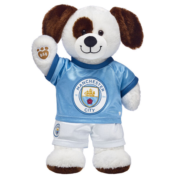 Goal! This cuddly stuffed animal gift set is a fun way to score with the football fan in your life! Ruff n' Tumble Puppy is ready to play on the pitch with its Manchester City football kit. It's a great gift for sports fans!