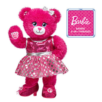 You can be anything with Barbie™ – and this gift set is sure to delight fans and collectors of all ages! Barbie™ Bear comes fully dressed in her signature dress and sparkly heels. <p>Price includes:</p>  <ul>    <li>Barbie™ Bear</li>    <li>Barbie™ Silver Polka Dot Dress </li>    <li>Barbie™ Fuchsia Sparkle Heels</li>    <li>Multicolour Sparkle Bow Set 4 pc.</li>    <li>Barbie™ 5-in-1 Phrases</li>  </ul>  ©2018 Mattel. All Rights Reserved.