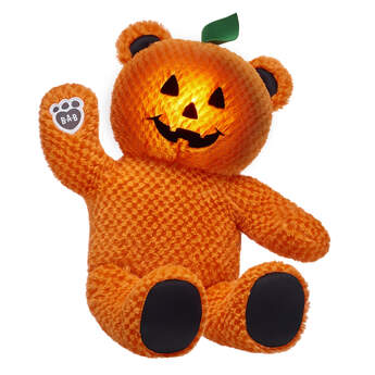 Pumpkin Glow Bear is the pick of the patch! This Halloween teddy bear has bright orange fur, black paw pads, a smiley jack-o'-lantern face and a lil' green leaf on its head. Plus, Pumpkin Glow Bear lights up! You can have your jack-o'-lantern furry friend light up the night with its special glow feature. Give someone special the perfect trick-or-treating partner with Pumpkin Glow Bear!