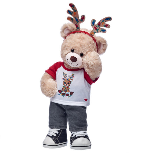 Happy Hugs is making it BEARY and bright this Christmas with this festive teddy bear gift set! This adorable plush teddy bear is getting in on the reindeer games with its fun T-shirt and cute antler headband.