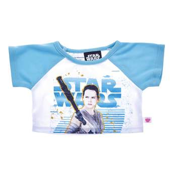 One of the biggest stars of the Star Wars franchise is at the forefront of this spectacular T-shirt! With light blue sleeves, this white T-shirt features the Star Wars logo in blue with Rey in front of it. Your furry friend can join Rey on her adventures throughout the galaxy with this cute T-shirt!  & ™ Lucasfilm Ltd.