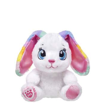 How sweet! With soft floppy ears and perfectly white fur, Sweet Stripes Bunny is just as cute as can be. With sky blue eyes and pink ears and paw pads, this 8-inch bunny also features colourful pastel stripes on its ears. Add Sweet Stripes Bunny to your Easter basket for a hoppin' fun time! NOTE: Build-A-Bear Buddies only fit in Build-A-Bear Buddies clothing. This item cannot be purchased unstuffed, nor can stuffing adjustments be made. A sound or scent cannot be placed inside this pre-stuffed item.