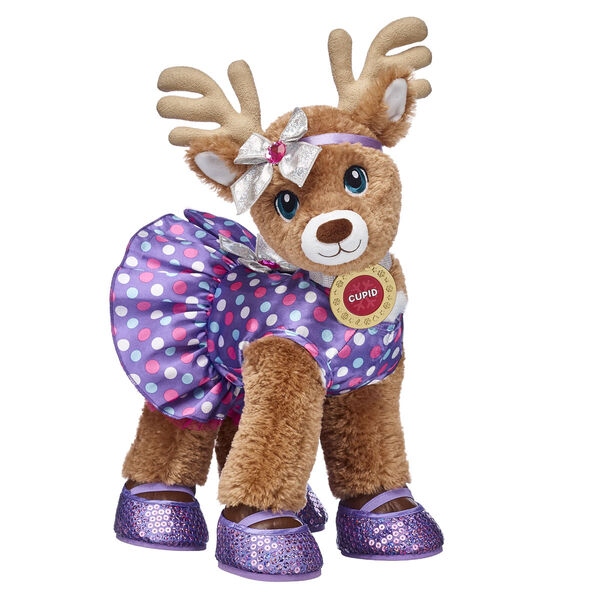 Nicknamed The Crafty Fashionista, Cupid is famous for creating her own unique style—and it's easy to see why! This stuffed animal reindeer gift set features Cupid fully dressed and rockin' her signature style. Capped off with her own medallion, Cupid is ready for any adventure the winter season brings!