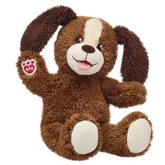 brown plush stuffed animal dog sitting