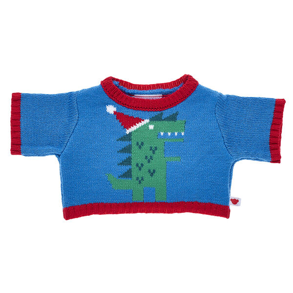RAWR! Your furry friend can stomp away with this cuddly Christmas sweater! This red and blue knit sweater features an adorable green dinosaur in a Santa hat.