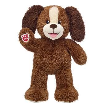 brown plush stuffed animal dog sitting