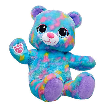 With a harmonious blend of multiple bright colours, Colourburst Bear's fur is an explosion of fluffy fun! With a fusion of blue, purple, pink and orange colours, this furry friend lights up any room with its big blue eyes and splashy personality. Colourburst Bear can also be outfitted in its own outfits and accessories to make a vibrant gift.