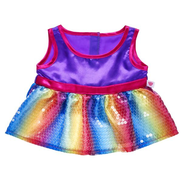 Add some colourful glam to your furry friend with this stylish dress! The skirt portion of this dress is a striped rainbow pattern and covered in glittery sequins. The sleeveless top portion is purple with fuchsia trim. You'll love playing dress-up with your furry friend and this beautiful outfit!
