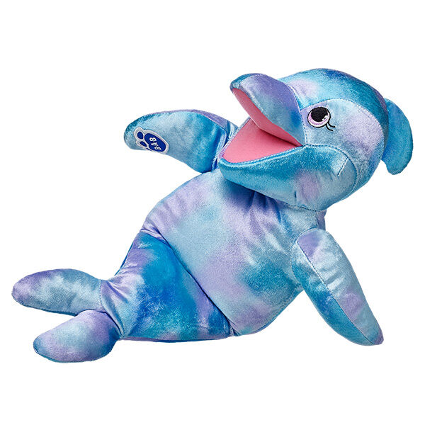 Dive into fun with Sea Splash Dolphin. This cool friend has a blue and purple body and fins. Personalise it with outfits and accessories to make the perfect unique gift.