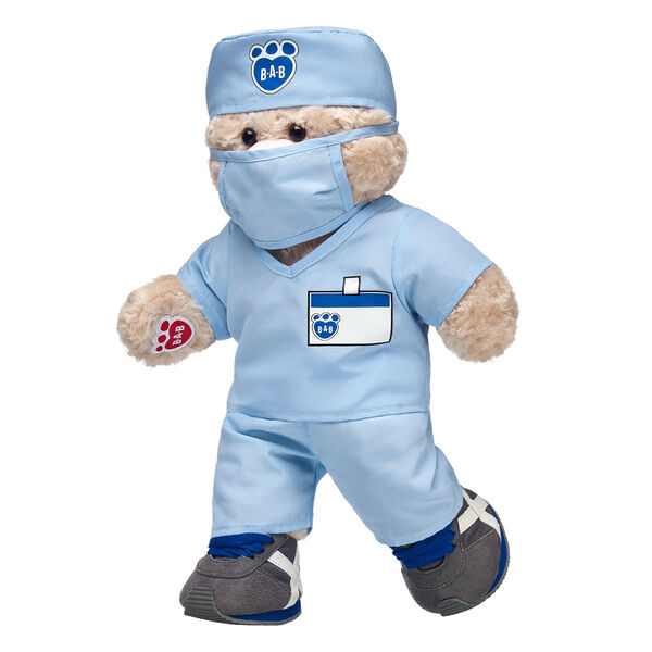 The doctor is in! Whether a child is going on a first doctor's visit or you want to send bear hugs to the medical professional in your life, this cuddly bear makes for a thoughtful gift.  <p>Price includes:</p>  <ul>    <li>Happy Hugs Teddy</li>     <li>Blue Scrubs 4 pc.</li>    <li>Gray & Blue Athletic Shoes</li> </ul>
