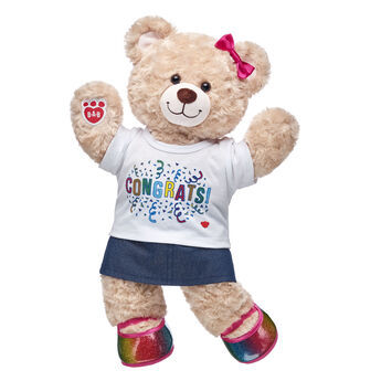 YAY! No matter what you're looking to celeBEARate, this cuddly gift set is an exciting choice! Happy Hugs is jumping for joy in its colourful outfit that includes a sparkly skirt and rainbow flats. Add bear hugs to any occasion with this fun gift set! <p>Price includes:</p>  <ul>    <li>Happy Hugs Teddy</li>     <li>Congrats T-Shirt</li>    <li>Sparkly Denim Skirt</li>    <li>Rainbow Sparkle Flats</li>    <li>Rainbow Bows 6 pc.</li> </ul>